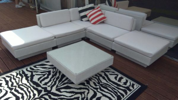white marrakesh sets with zebra rug and striped scatter cushions