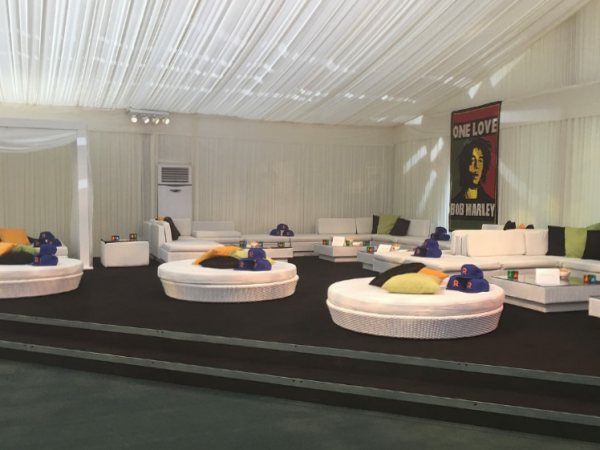 round white rattan daybeds with coloured scatter cushions