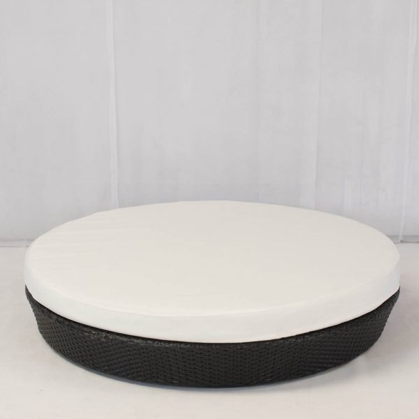 low circular daybed with black rattan base and cotton mattress;chill out furniture hire