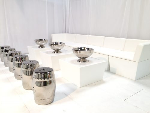 white faux leather sofas tables and taj silver stools