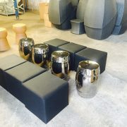 Black faux leather club ottomans and Taj Stools