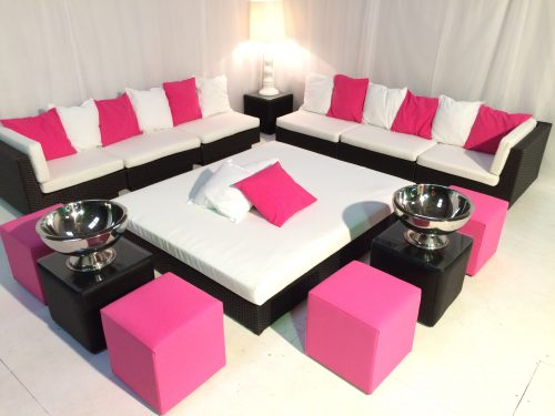 Black rattan furniture with pink faux leather cube seat and champagne bowls