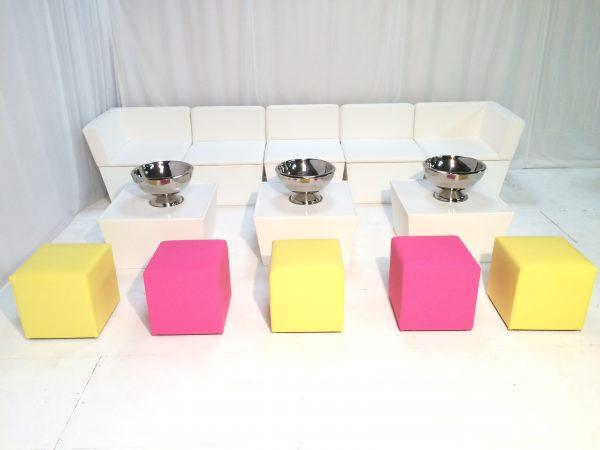 exhibition furniture hire: coloured ottomans