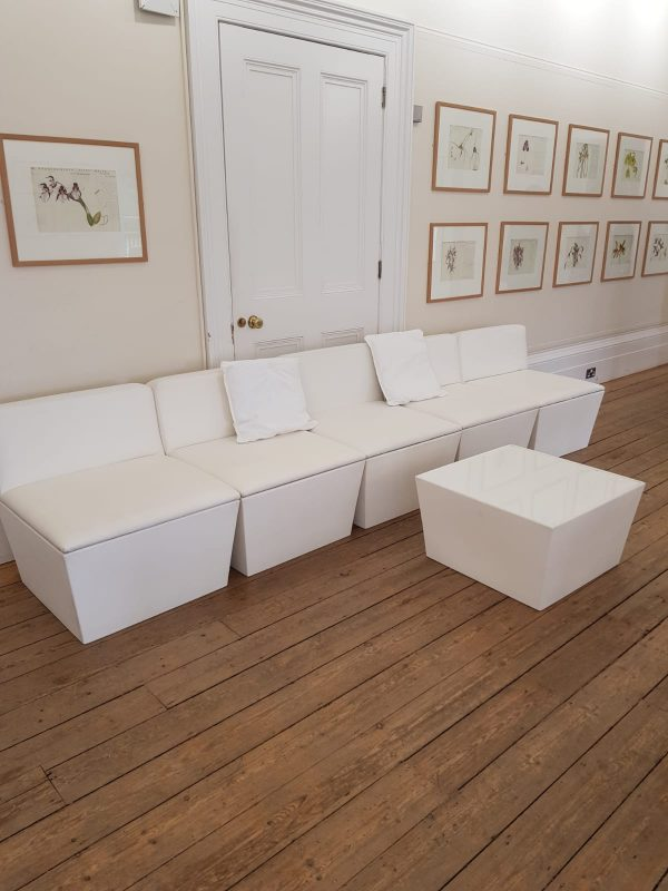 white faux leather padded seating with table