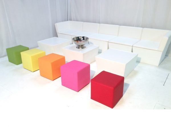 white faux leather sofa with coloured cube seats (green, yellow, orange, pink, red)