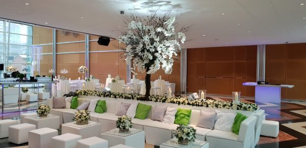 white faux leather sofa with floral arrangement