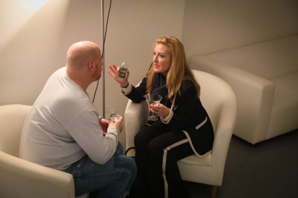 guests chatting in casa white armchair hire