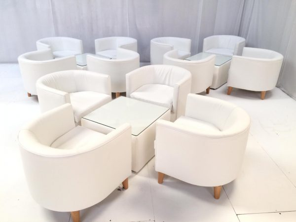 white furniture hire: curved white faux leather tub chairs with cubed white faux leather tables with glass top