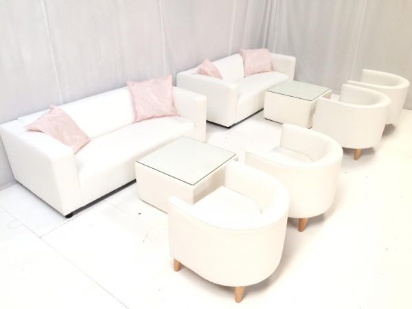 white faux lether armchairs with white sofas and white tables