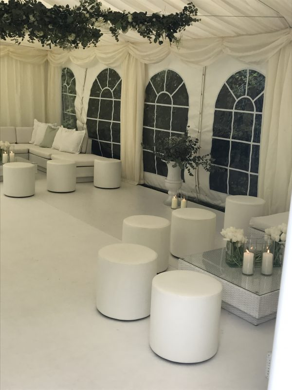 Club pouf with white marrakesh sofas tables and candles
