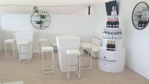 exhibition furniture hire:white cushion top stools with white poseur tables at moet epsom