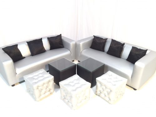 Silver faux leather club lounge sofas with black scatter cushions chesterfield ottomans and dark cabo tables with glass tops