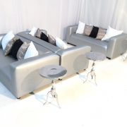 Silver faux leather club lounge sofas with scatter cushions and silver Sorbonne tables