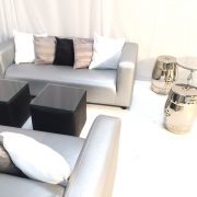Silver faux leather club lounge sofas with silver tables stools and faux leather tables with glass tops