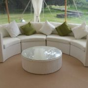 White Bulgari sofa set with green and white scatter cushions