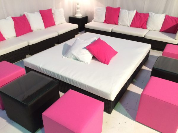 Tobago Black daybed hire with black rattan Marrakesh sofas hot pink scatter cushions and hot pink club ottomans