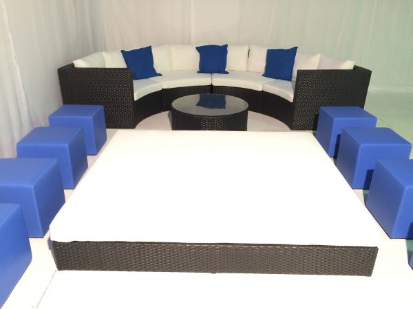 Tobago black daybed hire with black Bulgari sofa blue scatter cushions and blue club ottomans