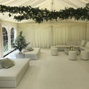 Tobago white daybed hire with Marrakesh sofas and faux leather club poufs