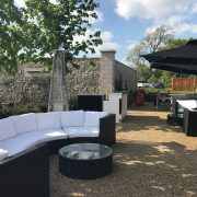 Dark Bulgari sofas at Golf Sixes event outside - clear sky