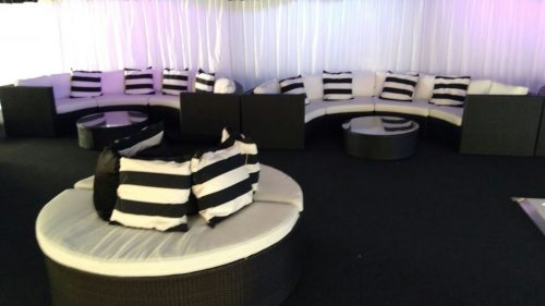 Banyan round sofas with Bulgari sets and black and white scatter cushions