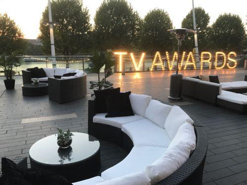 Black rattan outdoor sofa at TV Awards