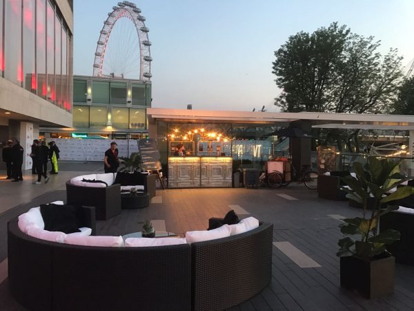Black rattan sofa outdoors London South Bank for TV Awards