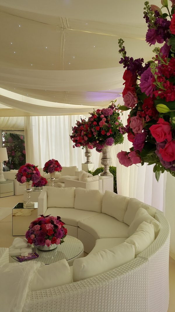 White Bulgari Sofa Sets with pink and red Flower arrangements