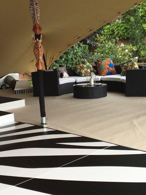 Dark Bulgari sofa in African safari style