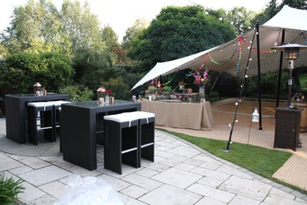 Four seater South beach bistro sets in black rattan near marquee