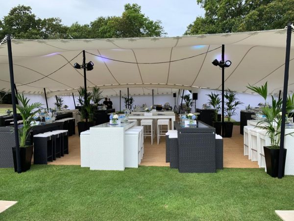 black and white rattan table and six seats at polo