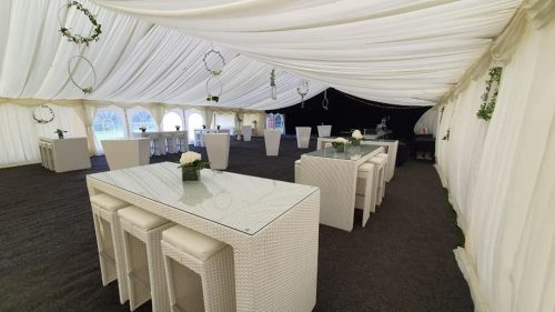 outdoor furniture hire: white rattan bistro furniture hire in marquee