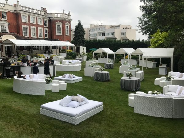 white rattan daybeds outdoors on grass at Bar Mitzvah