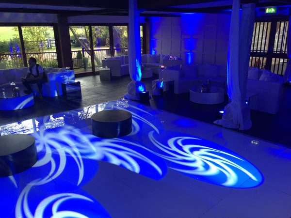 White Bulgari sofa sets near blue dancefloor