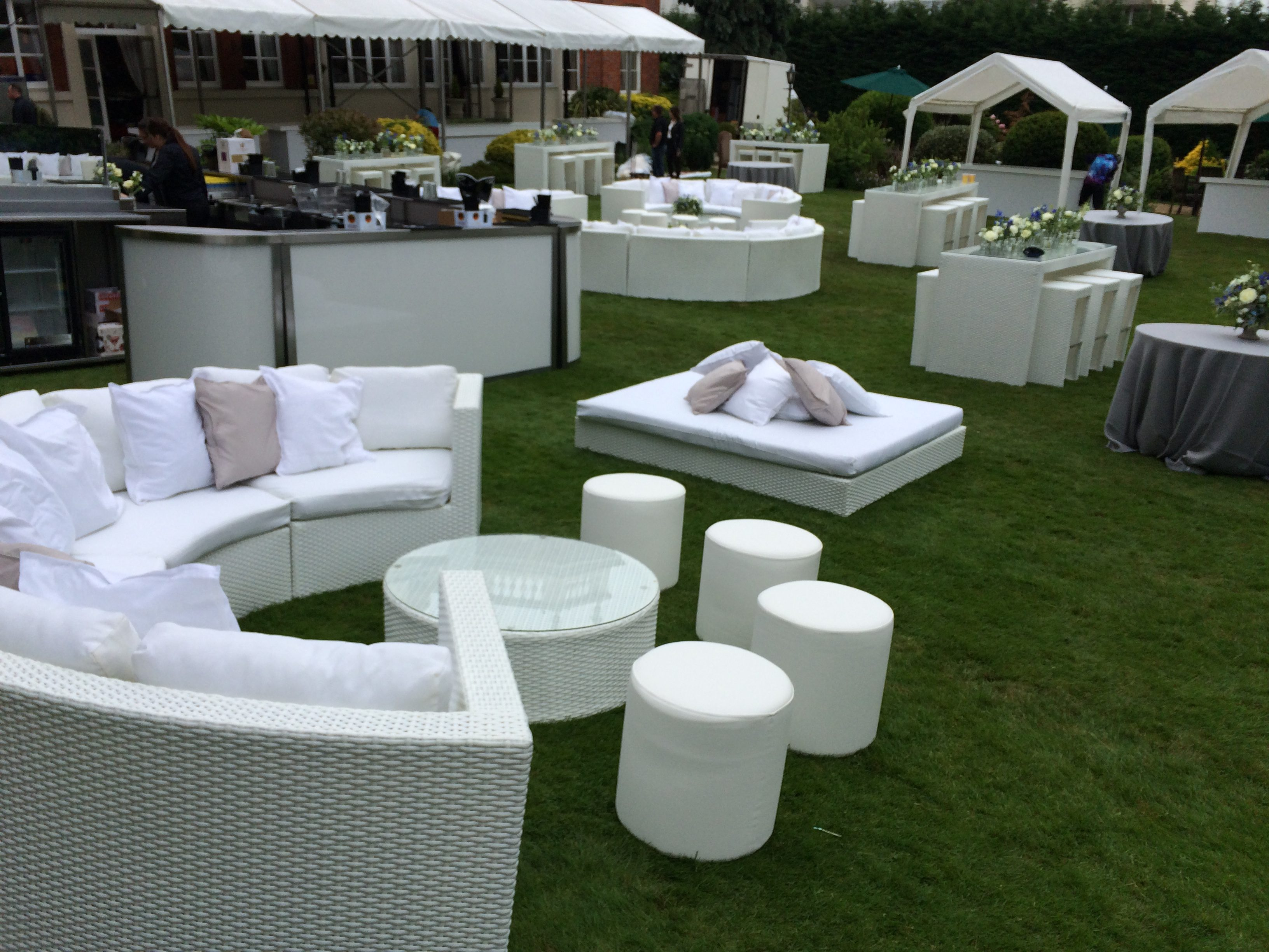 White rattan furniture and faux leather poufs hired for Bar Mitzvah at Hendon Hall