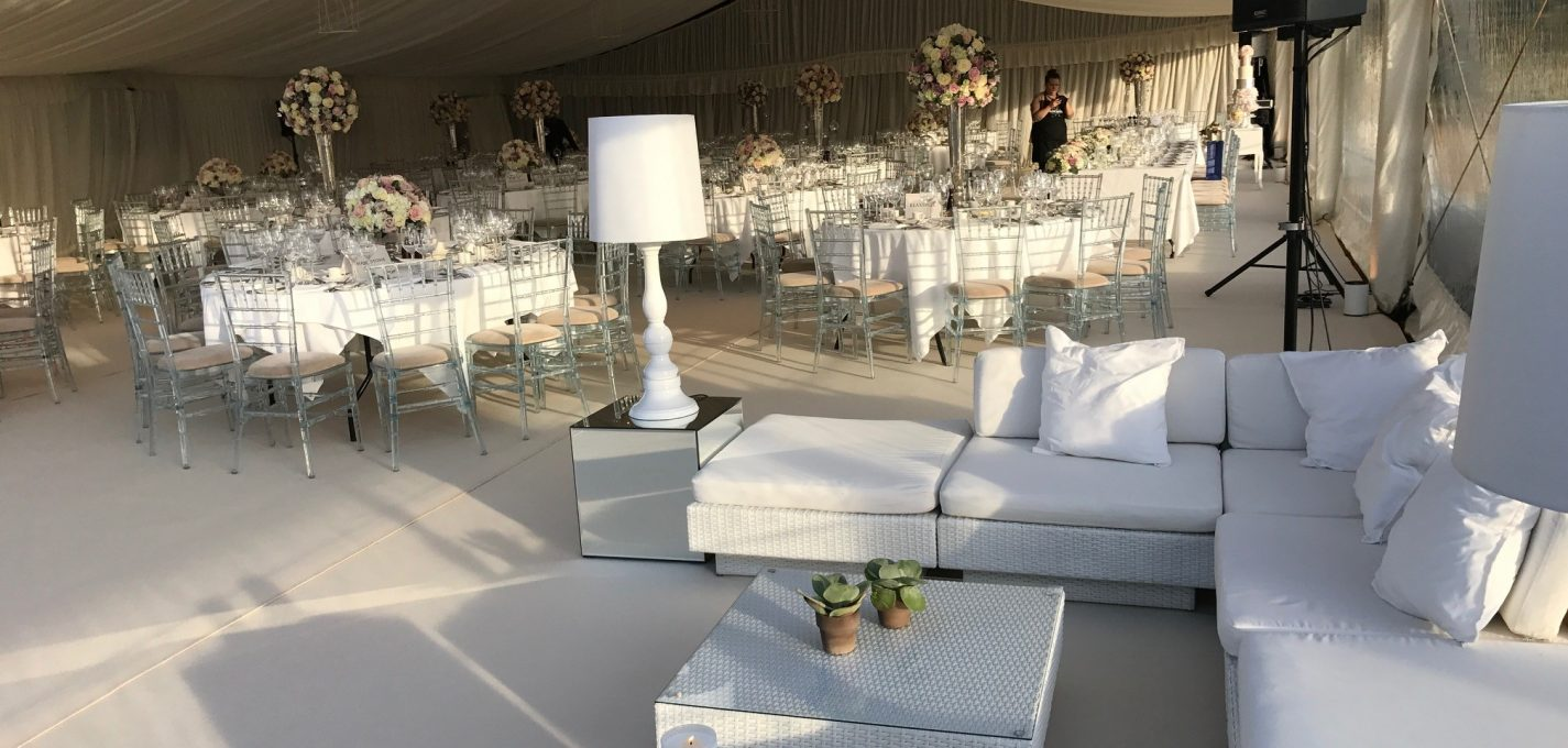Wedding Furniture For Hire: White rattan Marrakesh sofa sets with white scatter cushions and Fullerton Lamp