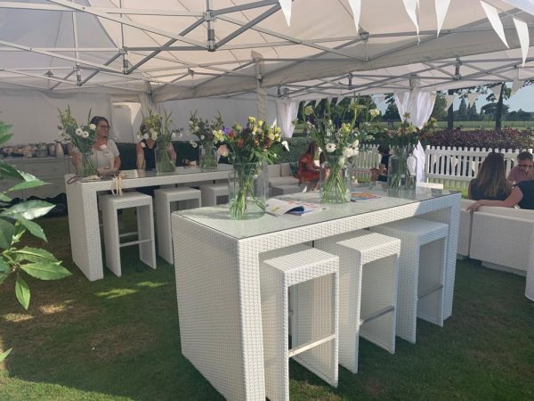 white rattan bistro table with six seats at food festival