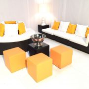banyan daybeds with rattan furniture and orange ottomans