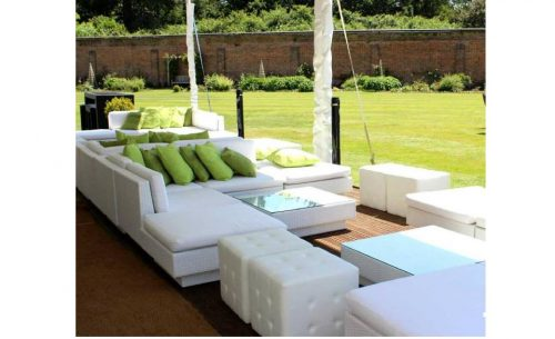 White Marrakesh rattan sofas with lime green scatter cushion and Chesterfield ottomans
