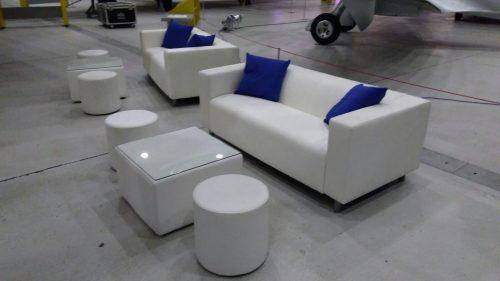 white faux leather sofas with white club poufs