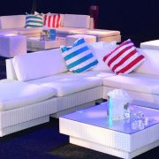 white sofas with turquoise and red striped scatter cushions