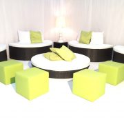 Set of daybeds with green accessories in VIP lounge