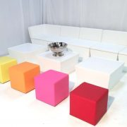 White faux leather sofas with coloured cube seats