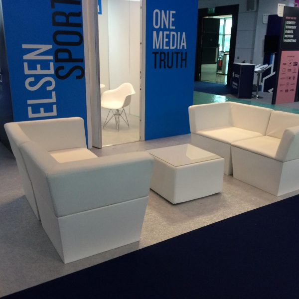 white faux leather sofa modules with faux leather large cabo table at exhibition