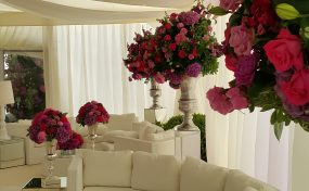sofas and flowers in marquee