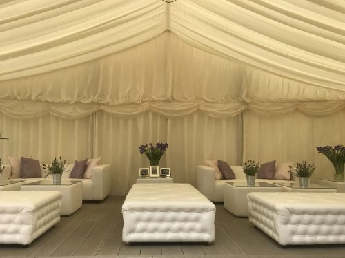 Faux leather Chesterfield Benches in marquee at outdoor garden party