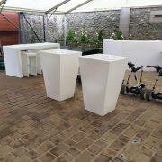 white poseur tables with patio heaters and rattan bistro furniture
