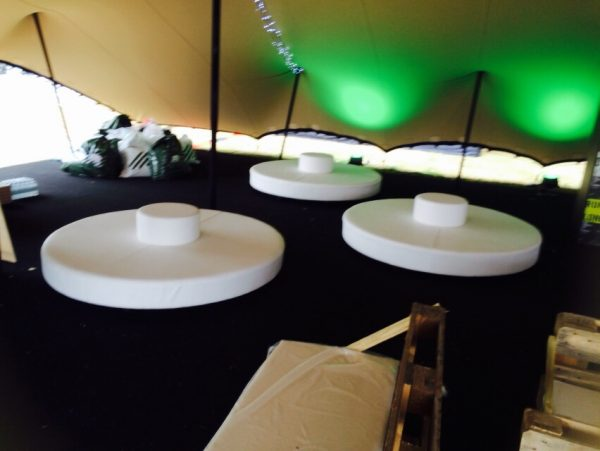 round daybeds in a marquee