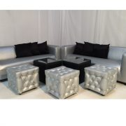 silver club sofa with black cabo table and silver chesterfield ottomans