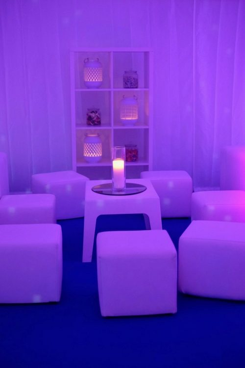 White furniture hire: white plastic mambo table and white faux leather cube seats