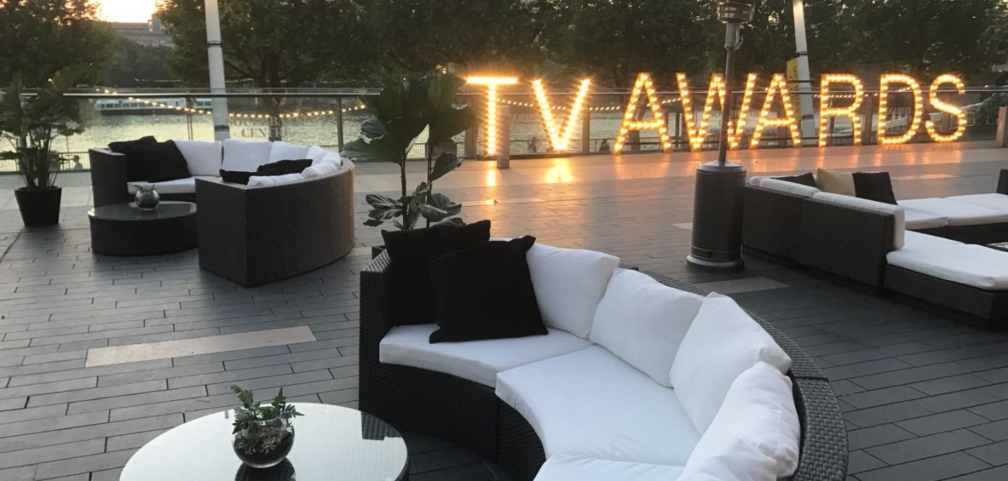 Awards Ceremony Furniture Hire: brown rattan sofas at tv awards with black cushions